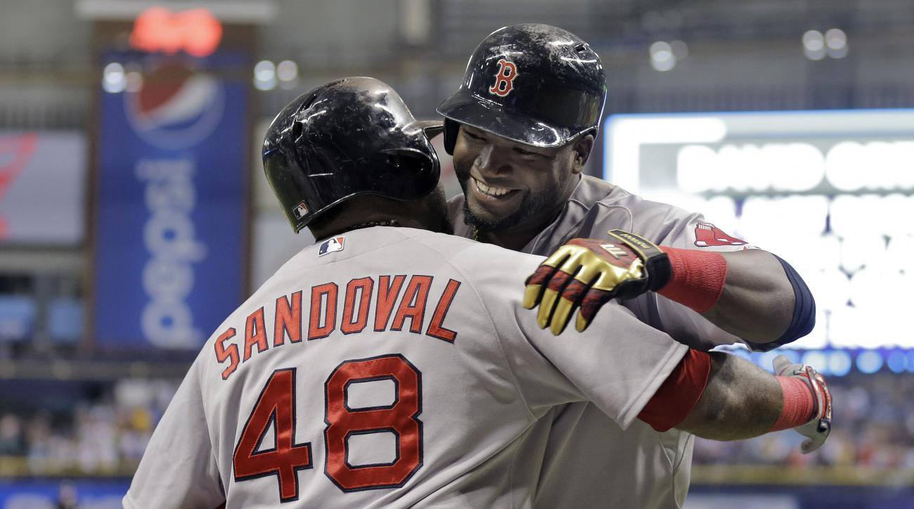 Boston Red Sox's David Ortiz, right, hugs Pablo Sandoval after Ortiz hit his 500th career home run off Tampa Bay Rays starting pitcher Matt Moore during the fifth inning of a baseball game Saturday, Sept. 12, 2015, in St. Petersburg, Fla.  (AP Photo/Chris