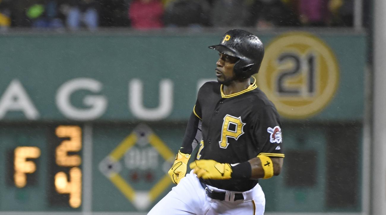 Pittsburgh Pirates' Andrew McCutchen rounds second base and heads for third against the Milwaukee Brewers in the third inning of a baseball game, Saturday, Sept. 12, 2015, in Pittsburgh. McCutchen advanced to third on a double by Pirates third baseman Ara