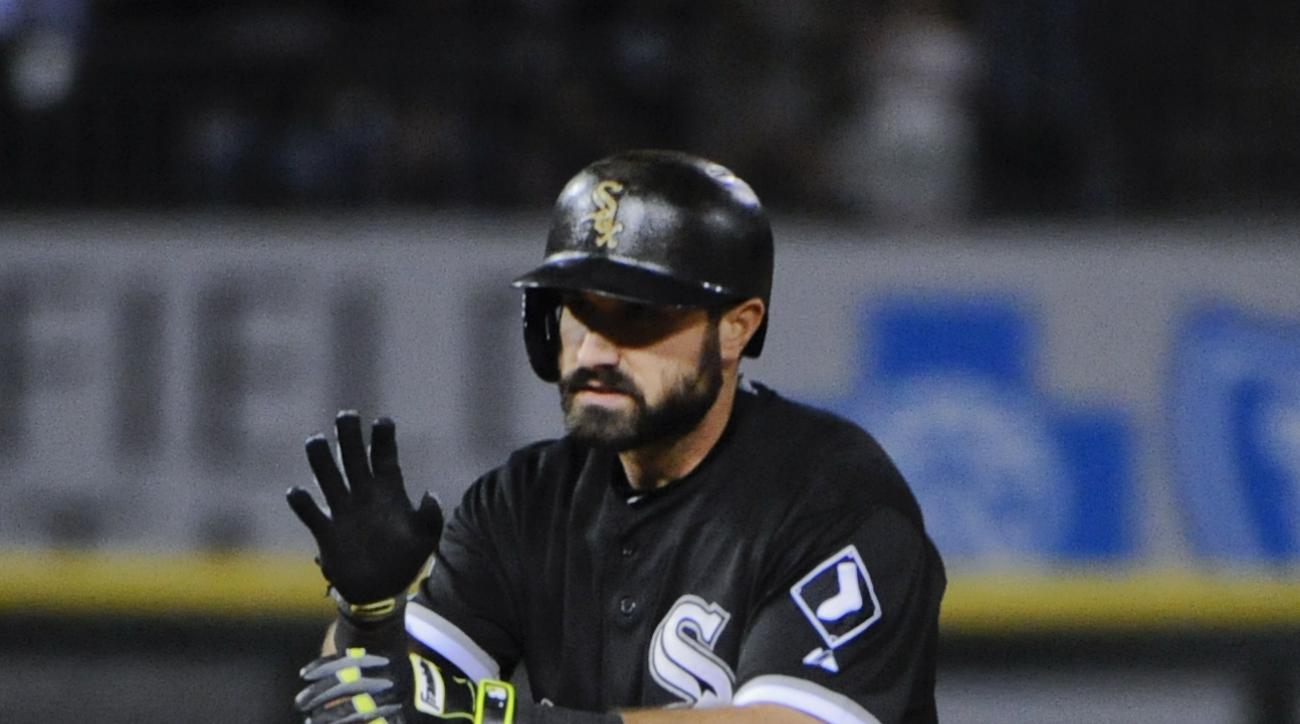 Chicago White Sox's Adam Eaton claps after he advanced to second base and teammate Geovany Soto scored in the fourth inning of a baseball game against the Minnesota Twins, Saturday, Sept. 12, 2015, in Chicago. (AP Photo/Matt Marton)