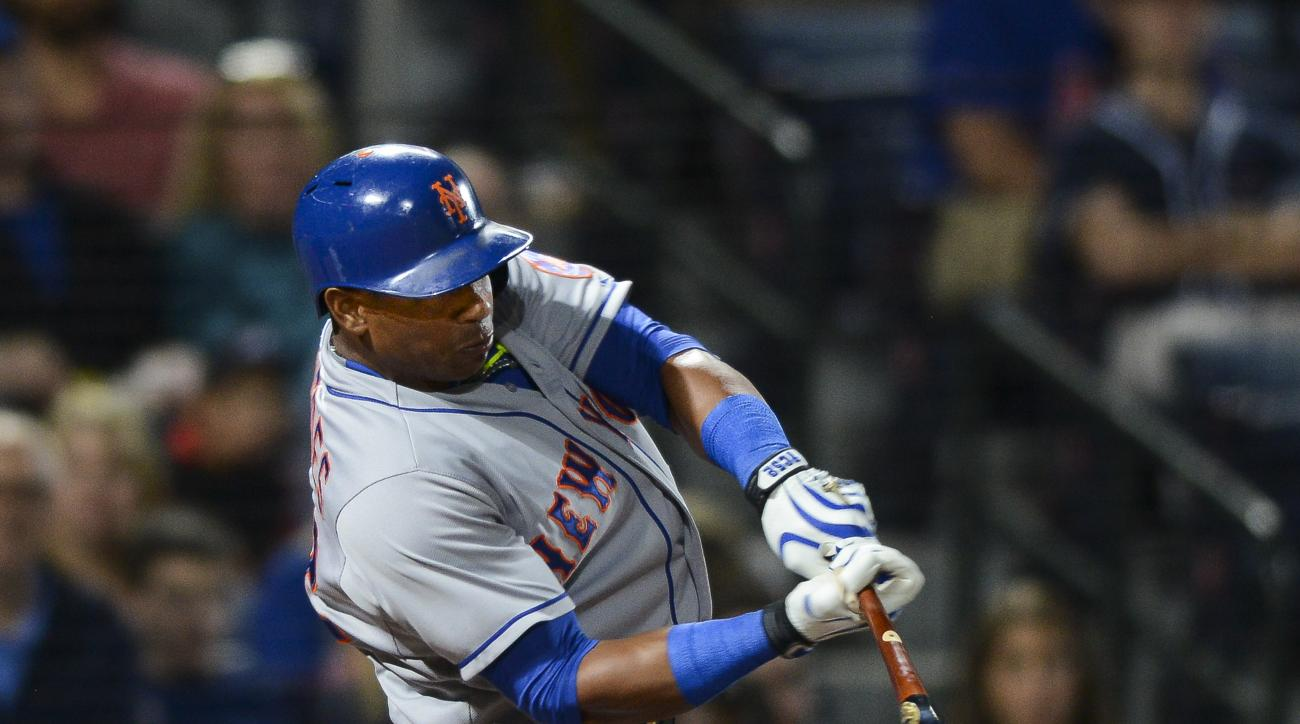 New York Mets center fielder Yoenis Cespedes hits a solo home run during the eighth inning of a baseball game against the Atlanta Braves, Saturday, Sept. 12, 2015, in Atlanta. (AP Photo/Jon Barash)