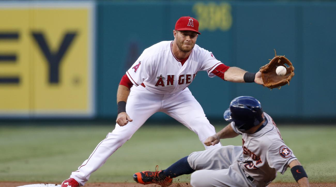 Houston Astros' Jose Altuve slides into second base as Los Angeles Angels second baseman Taylor Featherston prepares to make the tag during the first inning of a baseball game Saturday, Sept. 12, 2015 in Anaheim, Calif. Altuve was initially called safe bu