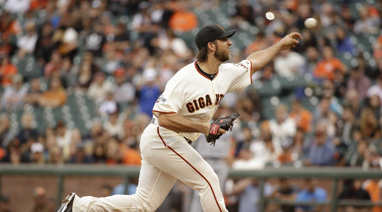 San Francisco Giants starting pitcher Madison Bumgarner throws during the first inning of the Giants' baseball game against the San Diego Padres on Saturday, Sept. 12, 2015, in San Francisco. (AP Photo/Eric Risberg)