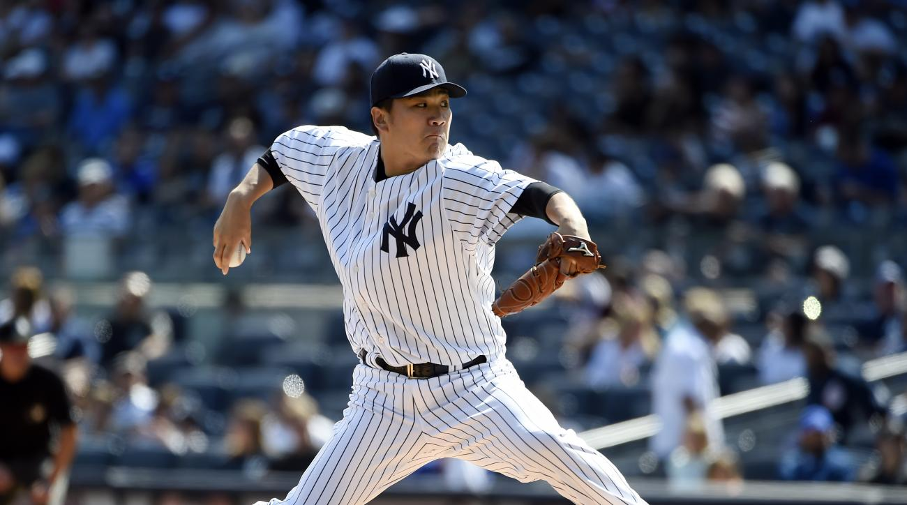 New York Yankees starter Masahiro Tanaka pitches in the first inning of a baseball game against the Toronto Blue Jays at Yankee Stadium, Sunday, Sept. 13, 2015, in New York. (AP Photo/Kathy Kmonicek)