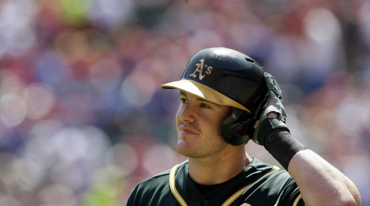 Oakland Athletics' Mark Canha heads back to the dugout after striking out during the third  inning of a baseball game against the Texas Rangers in Arlington, Texas, Sunday, Sept. 13, 2015. (AP Photo/LM Otero)