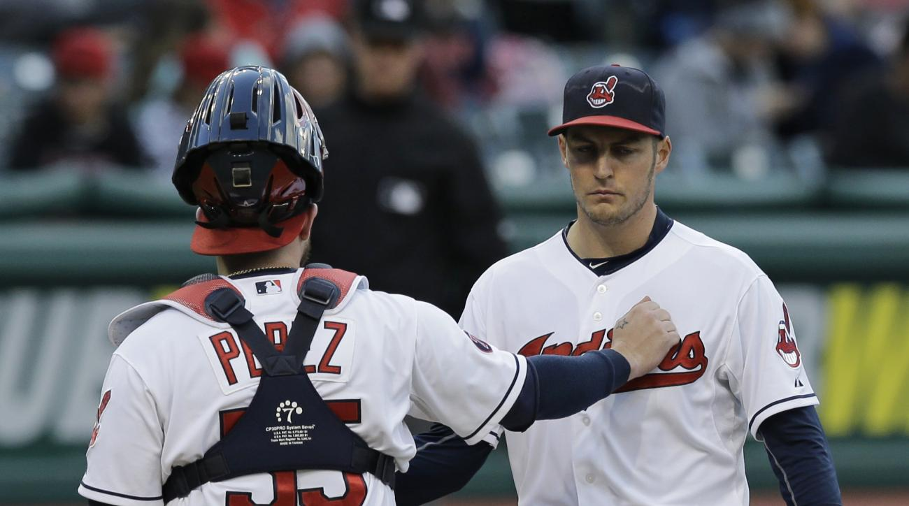 Cleveland Indians catcher Roberto Perez, left, talks with starting pitcher Trevor Bauer in the fourth inning of the second game of a baseball doubleheader against the Detroit Tigers, Sunday, Sept. 13, 2015, in Cleveland. (AP Photo/Tony Dejak)