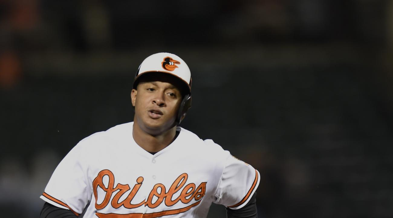 Baltimore Orioles' Jonathan Schoop runs to third base after hitting his second home run of the game against the Kansas City Royals in the fourth inning of a baseball game, Sunday, Sept. 13, 2015, in Baltimore. (AP Photo/Gail Burton)