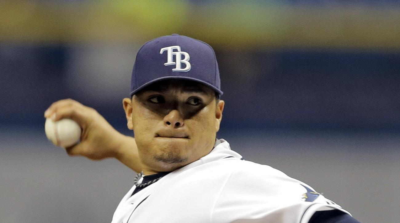 Tampa Bay Rays starting pitcher Erasmo Ramirez delivers to the New York Yankees during the first inning of a baseball game Monday, Sept. 14, 2015, in St. Petersburg, Fla.  (AP Photo/Chris O'Meara)