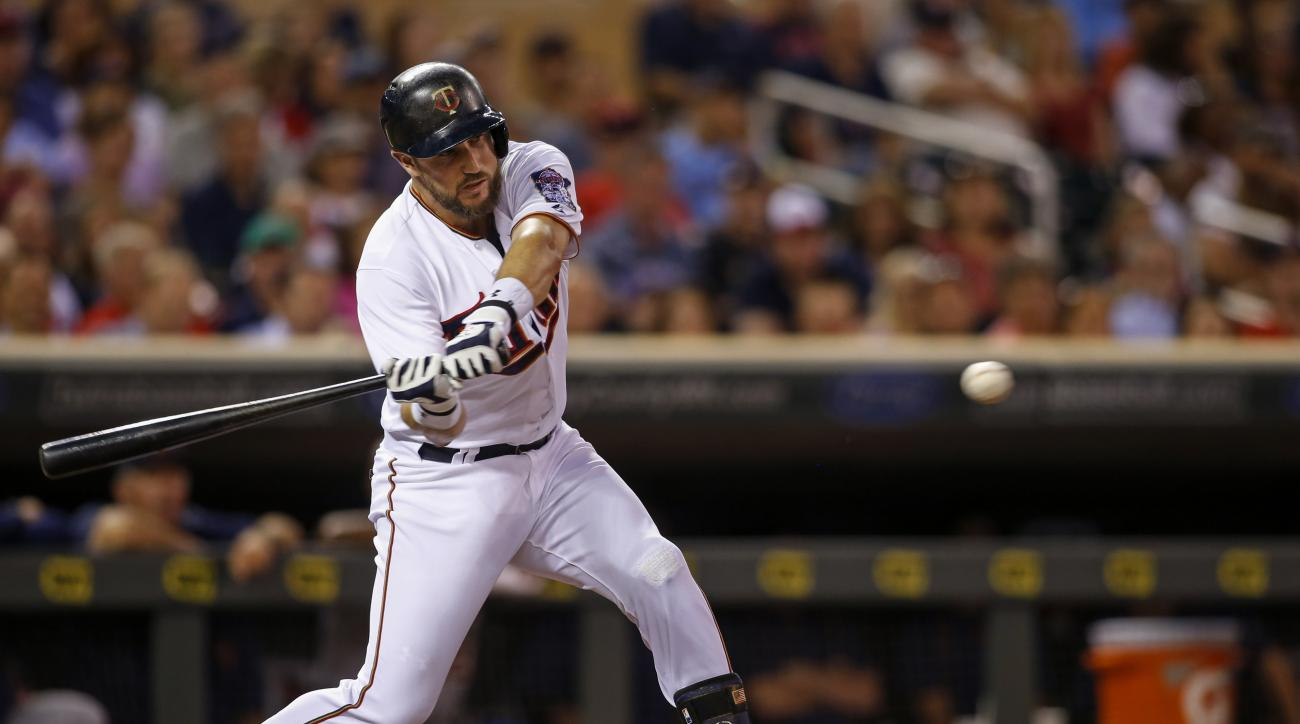 Minnesota Twins third baseman Trevor Plouffe (24) hits a two run double against the Detroit Tigers in the first inning of a baseball game, Monday, Sept. 14, 2015, in Minneapolis. (AP Photo/Bruce Kluckhohn)