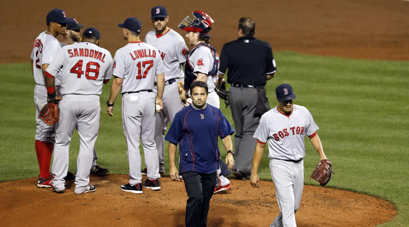 Boston Red Sox starting pitcher Joe Kelly, bottom right, walks off the field after being relieved in the third inning of a baseball game against the Baltimore Orioles, Tuesday, Sept. 15, 2015, in Baltimore. (AP Photo/Patrick Semansky)
