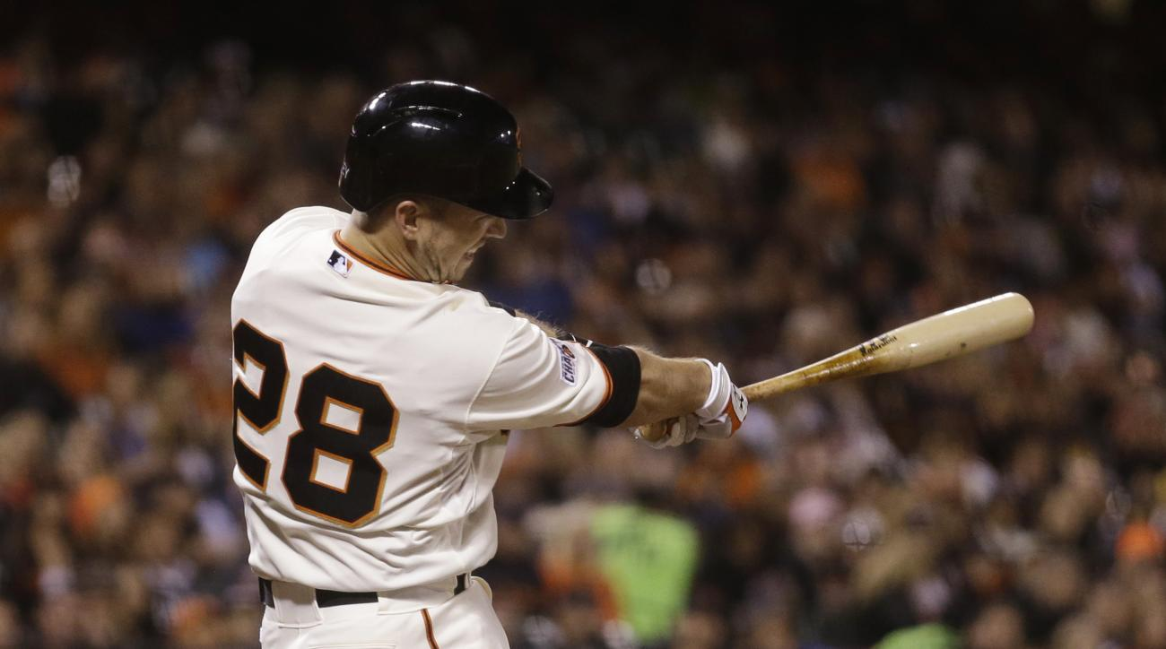 San Francisco Giants' Buster Posey follows through on a three-run home run off Cincinnati Reds' John Lamb during the fourth inning of a baseball game Tuesday, Sept. 15, 2015, in San Francisco. (AP Photo/Ben Margot)