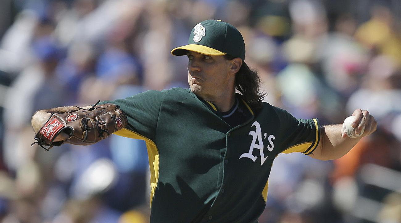 FILE - In this Tuesday, March 24, 2015 file photo, Oakland Athletics' Barry Zito works against the Chicago Cubs in the fourth inning of a spring training exhibition baseball game in Mesa, Ariz. The Oakland Athletics are bringing up former Cy Young Award w