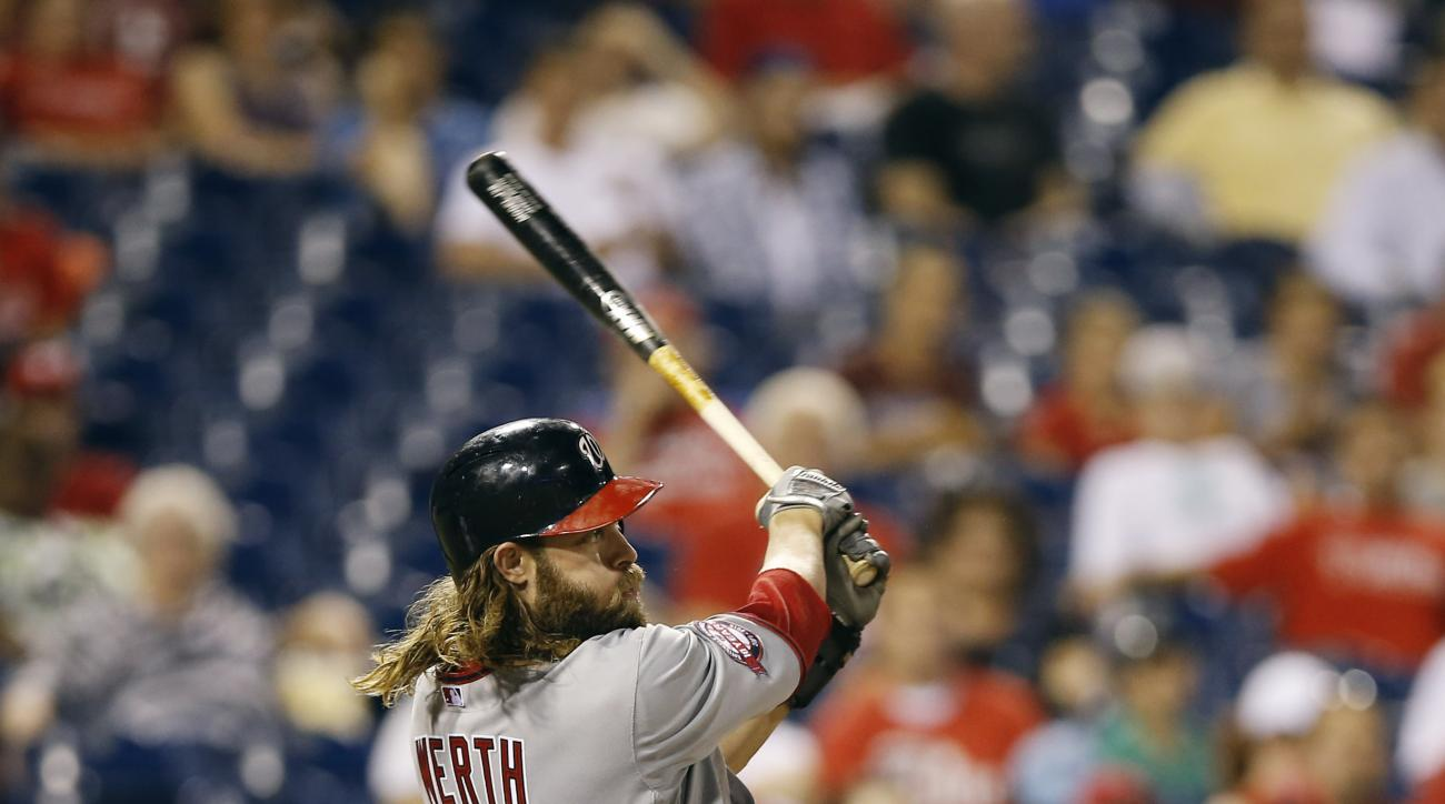 Washington Nationals' Jayson Werth follows through after hitting a home run off Philadelphia Phillies starting pitcher Alec Asher during the fourth inning of a baseball game, Wednesday, Sept. 16, 2015, in Philadelphia. (AP Photo/Matt Slocum)