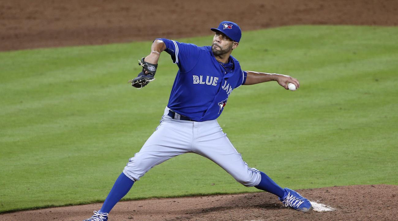 Toronto Blue Jays starting pitcher David Price (14) works the fifth inning of a baseball game against the Atlanta Braves Wednesday, Sept. 16, 2015, in Atlanta. (AP Photo/John Bazemore)