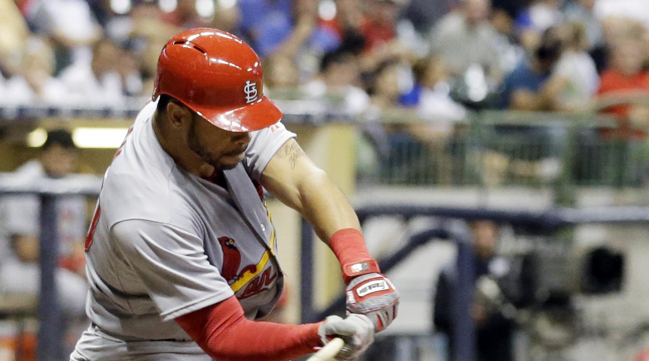 St. Louis Cardinals' Thomas Pham hits a triple during the sixth inning of a baseball game against the Milwaukee Brewers Wednesday, Sept. 16, 2015, in Milwaukee. (AP Photo/Morry Gash)