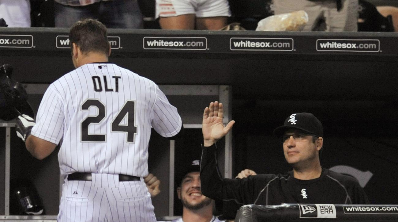 Chicago White Sox's Mike Olt (24) celebrates with manager Robin Ventura, right, and teammate Tyler Flowers (21), after hitting a two-run home run during the fourth inning of a baseball game against the Oakland Athletics on Wednesday, Sept. 16, 2015, in Ch