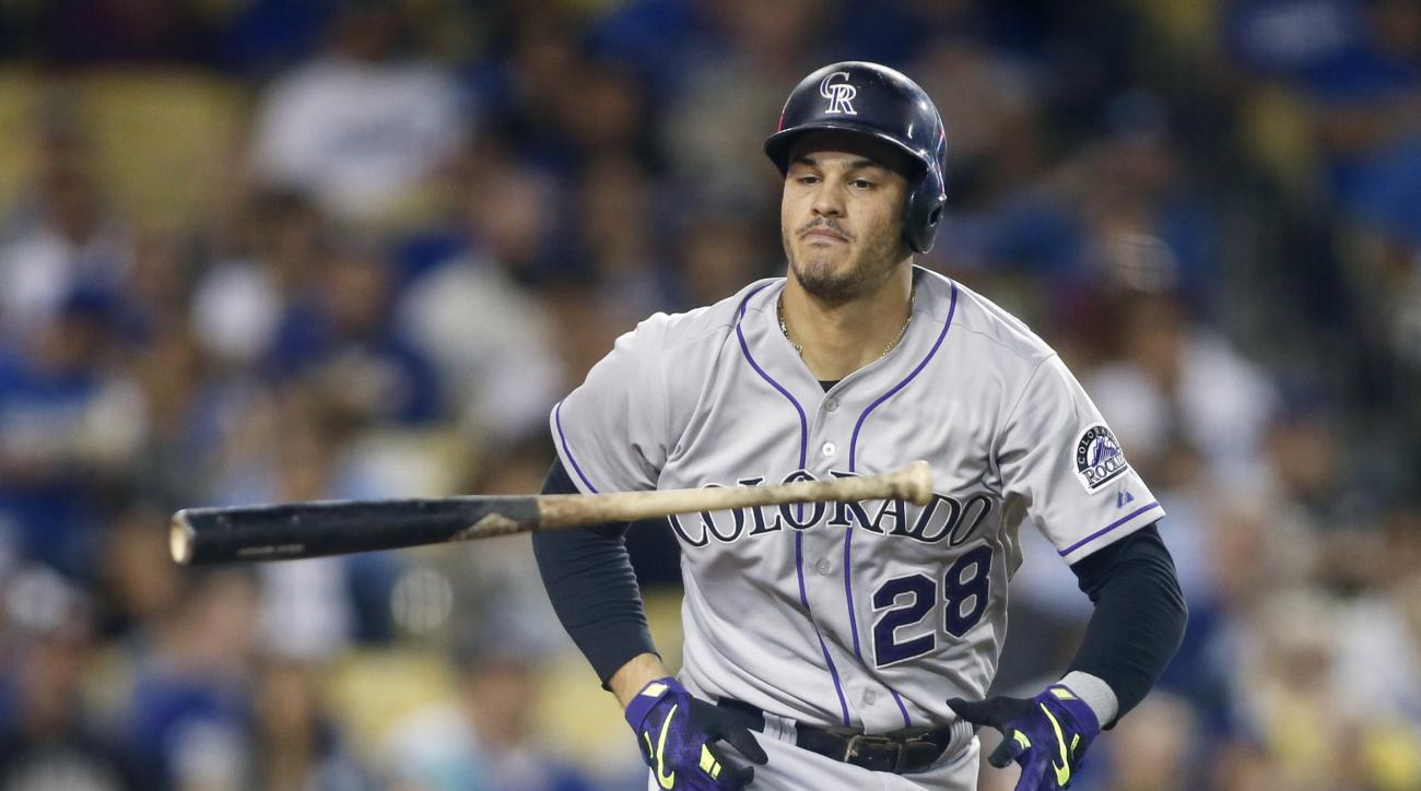 Colorado Rockies' Nolan Arenado tosses his bat as he grounds out to the pitcher during the fourth inning of a baseball game against the Los Angeles Dodgers, Wednesday, Sept. 16, 2015, in Los Angeles. (AP Photo/Danny Moloshok)