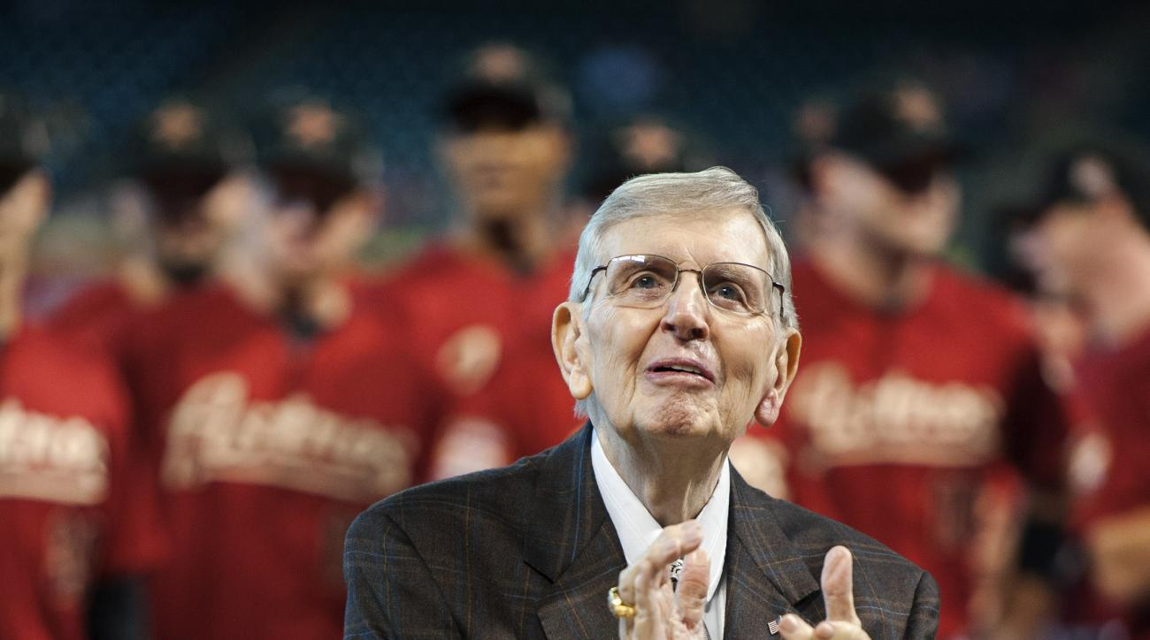 FILE - In this Sept. 2, 2012, file photo, Houston Astros radio broadcaster Milo Hamilton reacts as fans sing to celebrate his 85th birthday before a baseball game against the Cincinnati Reds in Houston. Hamilton, the longtime play-by-play radio voice of t