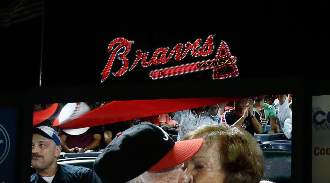 "Former President Jimmy Carter kisses his wife,Rosalynn, on the ""Kiss Cam"" during a baseball game between the Atlanta Braves and the Toronto Blue Jays on Thursday, Sept. 17, 2015, in Atlanta. Carter recently announced he has cancer. (AP Photo/John Bazemore"