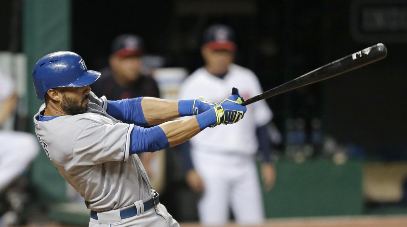 Kansas City Royals' Alex Rios hits a double off Cleveland Indians relief pitcher Gavin Floyd during the seventh inning of a baseball game, Thursday, Sept. 17, 2015, in Cleveland. (AP Photo/Tony Dejak)