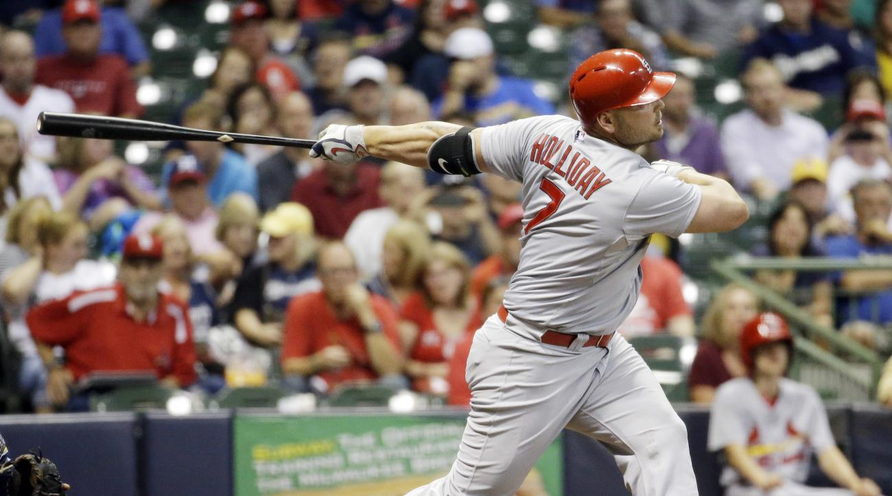 St. Louis Cardinals' Matt Holliday strikes out as he pinch hits during the seventh inning of a baseball game against the Milwaukee Brewers Thursday, Sept. 17, 2015, in Milwaukee. The game was Holliday's first game back since July 30. (AP Photo/Morry Gash)