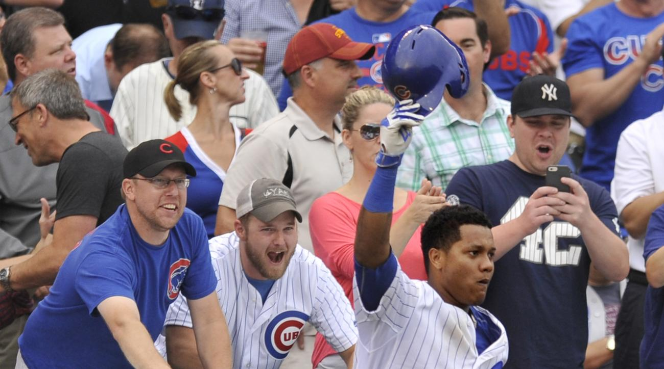 Chicago Cubs' Starlin Castro (13), tips his hat to the crowd after hitting a three-run home run during the sixth inning of a baseball game against the St. Louis Cardinals Friday, Sept. 18, 2015 in Chicago. (AP Photo/Paul Beaty)