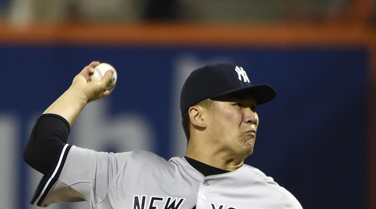 New York Yankees starter Masahiro Tanaka pitches against the New York Mets in the second inning of a baseball game, Friday, Sept. 18, 2015, in New York. (AP Photo/Kathy Kmonicek)