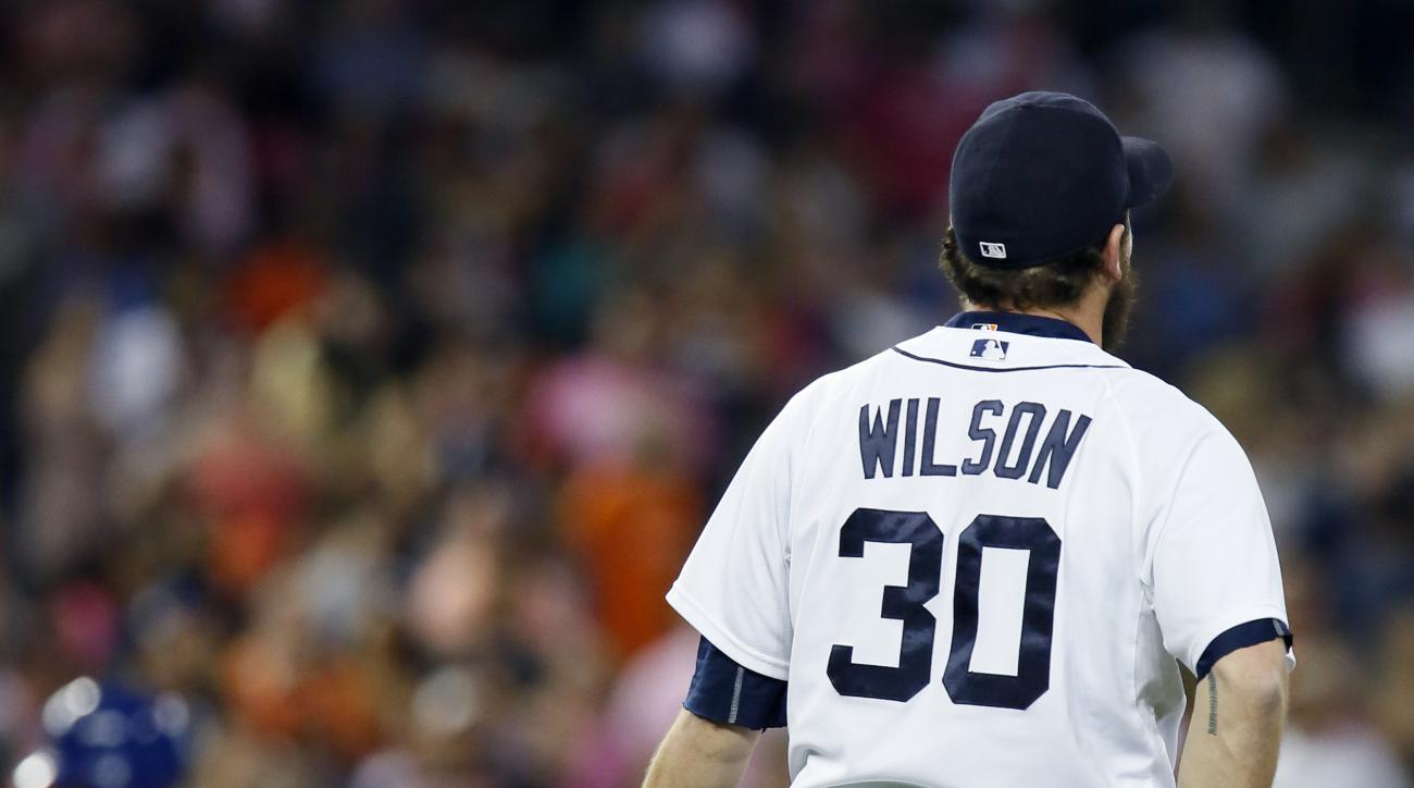 Detroit Tigers pitcher Alex Wilson stands near the mound after giving up a two-run home run to Kansas City Royals' Salvador Perez, left, that ties the game at 3-3 during the ninth inning of a baseball game at Comerica Park Friday, Sept. 18, 2015, in Detro