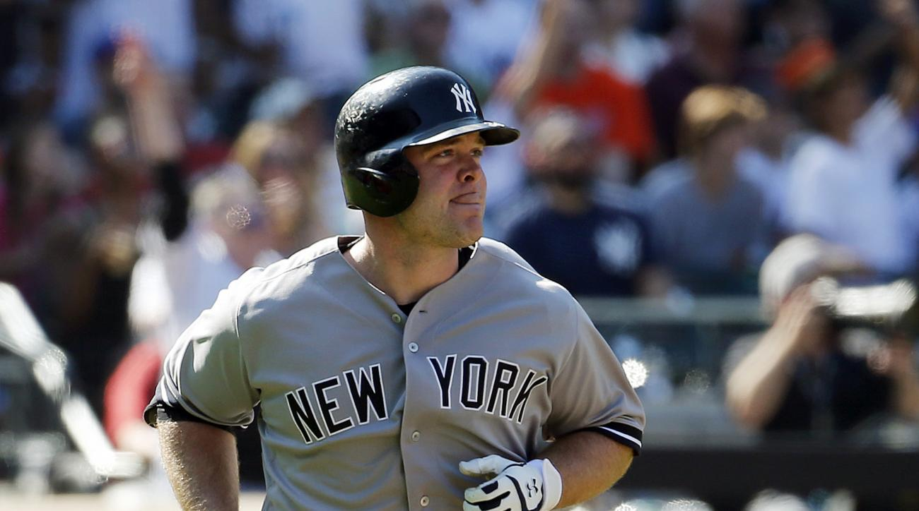 New York Yankees' Brian McCann hits a two run home run off New York Mets starting pitcher Noah Syndergaard during the sixth inning of a baseball game, Saturday, Sept. 19, 2015, in New York. (AP Photo/Julio Cortez)