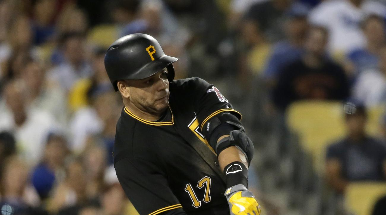 Pittsburgh Pirates' Aramis Ramirez hits an RBI single against the Los Angeles Dodgers during the eighth inning of a baseball game in Los Angeles, Saturday, Sept. 19, 2015. (AP Photo/Chris Carlson)