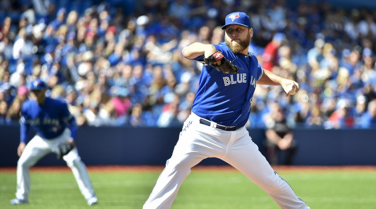 Toronto Blue Jays' starting pitcher Mark Buehrle works against the Boston Red Sox during the first inning of a baseball game in Toronto on Sunday, Sept. 20, 2015. (Nathan Denette/The Canadian Press via AP)