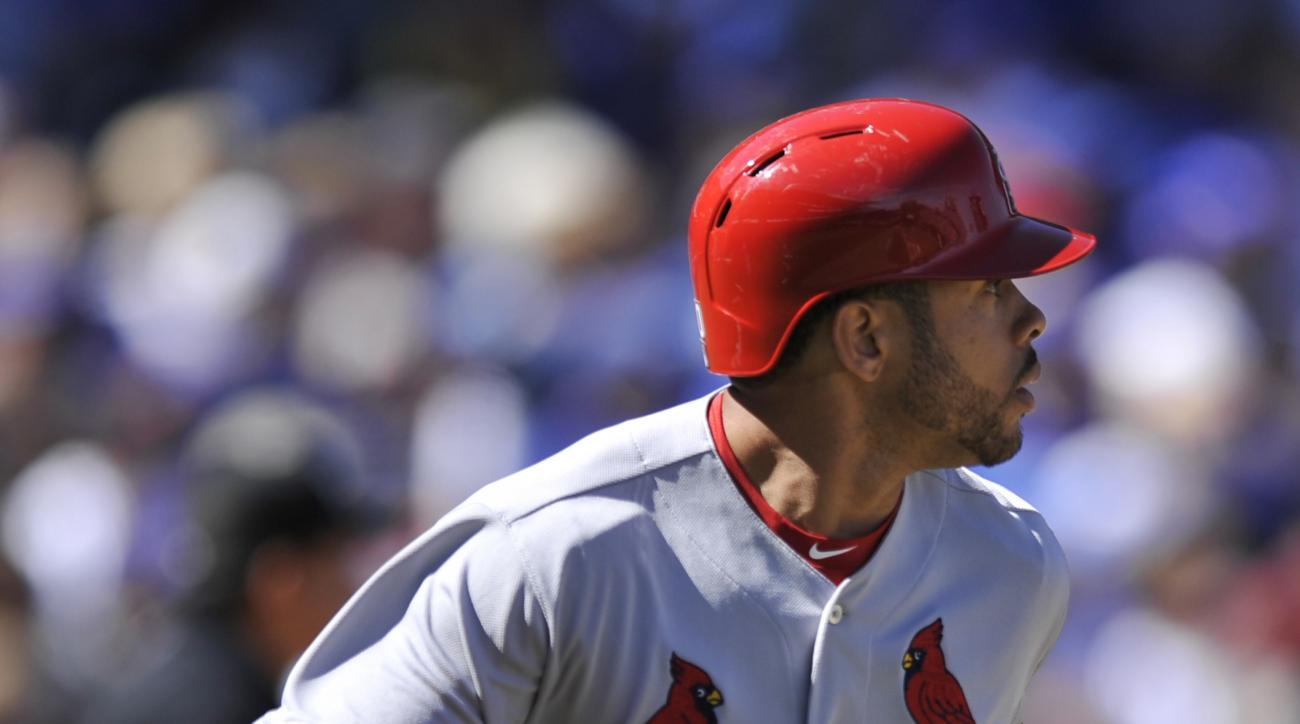 St. Louis Cardinals' Tommy Pham (60), watches his solo home run during the first inning of a baseball game against the Chicago Cubs Sunday, Sept. 20, 2015 in Chicago. (AP Photo/Paul Beaty)