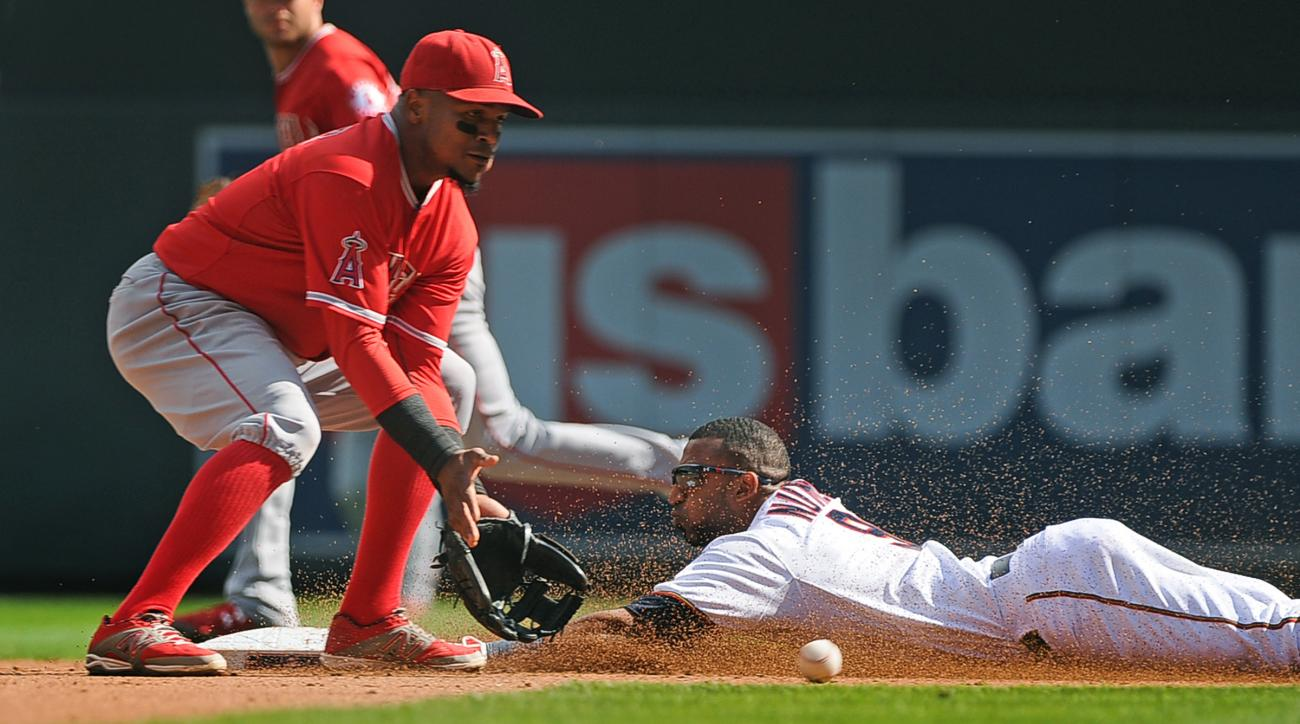 Minnesota Twins base runner Eduardo Nunez steals second base as Los Angeles Angels shortstop Erick Aybar fields the throw in the fourth inning of a baseball game, Sunday, Sept. 20, 2015, in Minneapolis. (AP Photo/Richard Marshall)