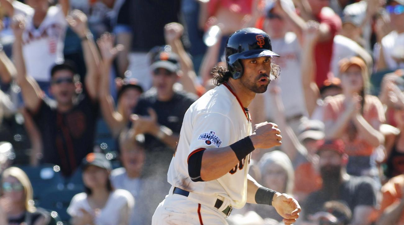 San Francisco Giants' Angel Pagan reacts after scoring against the Arizona Diamondbacks during the sixth inning of a baseball game, Sunday, Sept. 20, 2015, in San Francisco. (AP Photo/George Nikitin)