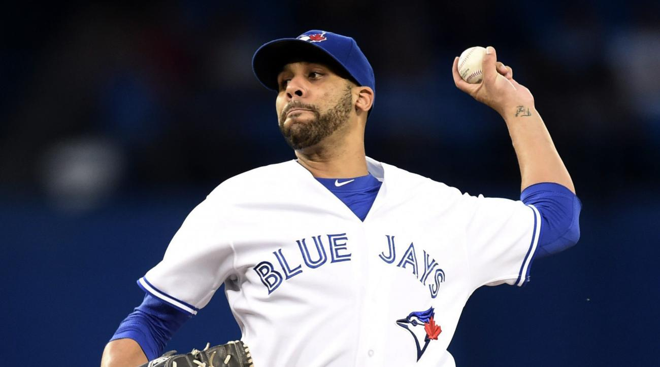 Toronto Blue Jays' starting pitcher David Price works against the New York Yankees during first-inning baseball game action in Toronto, Monday, Sept. 21, 2015. (Frank Gunn/The Canadian Press via AP) MANDATORY CREDIT