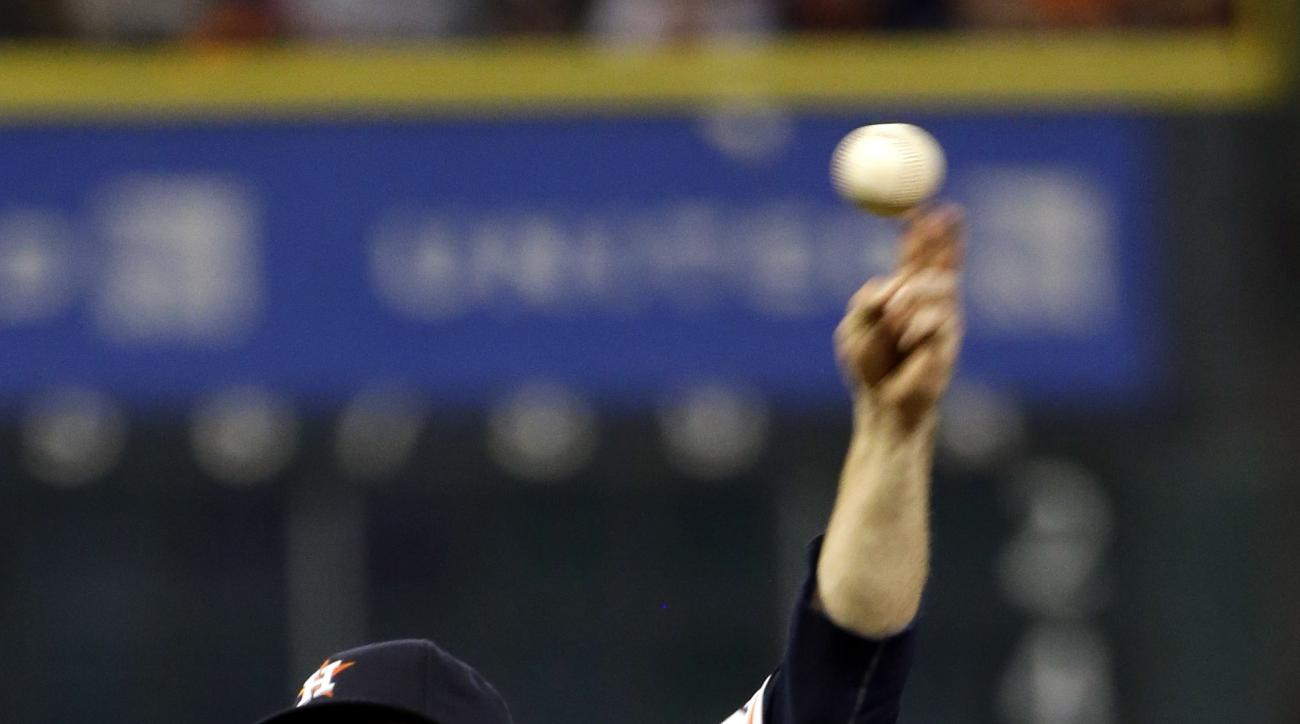 Houston Astros starting pitcher Dallas Keuchel throws against the Los Angeles Angels during the eighth inning of a baseball game, Monday, Sept. 21, 2015, in Houston. (AP Photo/David J. Phillip)