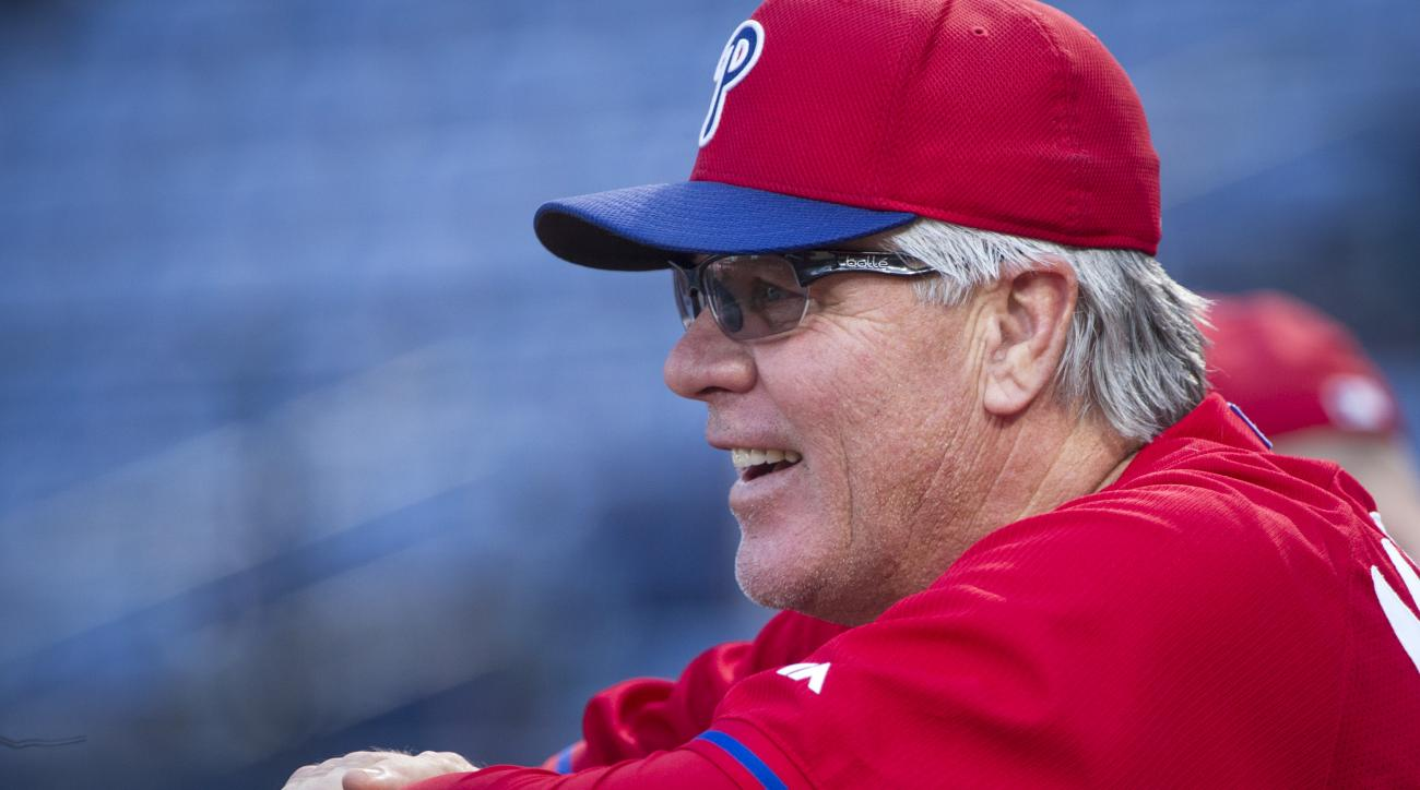 Philadelphia Phillies interim manager Pete Mackanin (45) watches his team warm up before a baseball game against the Atlanta Braves, Friday, Sept. 18, 2015, in Atlanta. (AP Photo/John Amis)