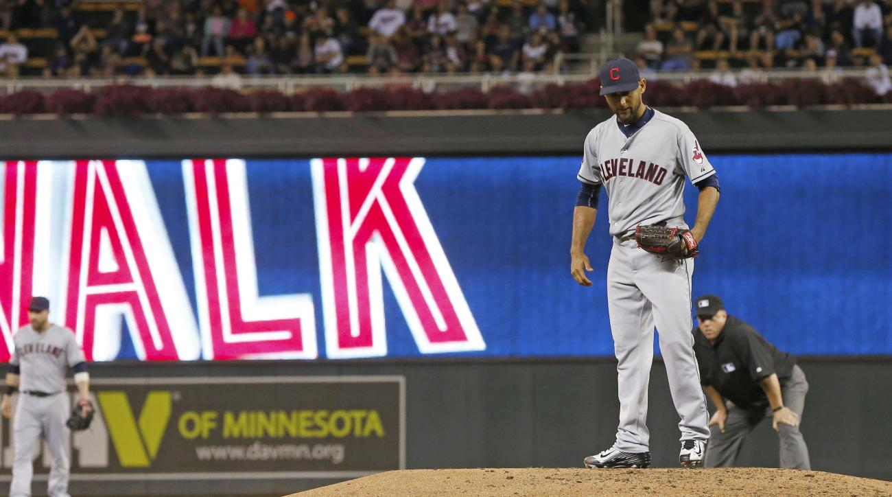 Cleveland Indians pitcher Danny Salazar gives up a walk to Minnesota Twins' Miguel Sano in the third inning of a baseball game, Tuesday, Sept. 22, 2015, in Minneapolis. Salazar gave up three runs in the inning.  (AP Photo/Jim Mone)