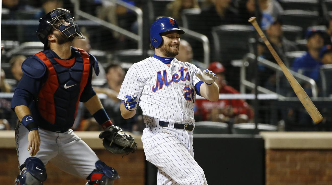New York Mets Daniel Murphy tosses his bat after popping out to short with a runner in scoring position in the eighth inning of a baseball game against the Atlanta Braves in New York, Tuesday, Sept. 22, 2015. (AP Photo/Kathy Willens)