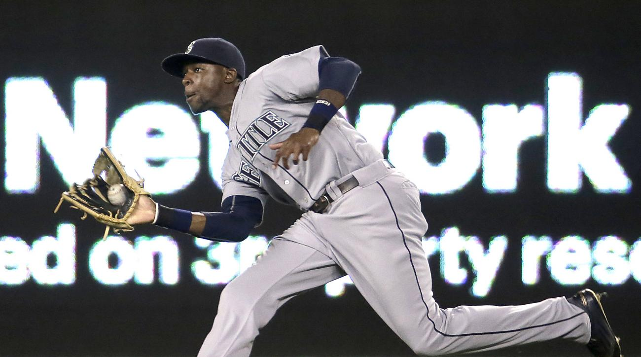 Seattle Mariners center fielder James Jones catches a fly ball for the out on Kansas City Royals' Eric Hosmer during the sixth inning of a baseball game Tuesday, Sept. 22, 2015, in Kansas City, Mo. (AP Photo/Charlie Riedel)