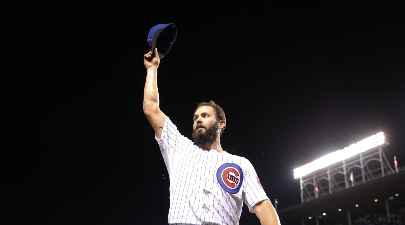 Chicago Cubs starting pitcher Jake Arrieta waves to fans after a 4-0 win over the Milwaukee Brewers in a baseball game Tuesday, Sept. 22, 2015, in Chicago. Arrieta became the majors' first 20-game winner of the season. (AP Photo/Charles Rex Arbogast)