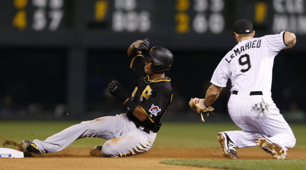 Pittsburgh Pirates pinch-runner Keon Broxton, left, slides into second base after being tagged out by Colorado Rockies second baseman DJ LeMahieu on a steal attempt during the seventh inning of a baseball game Tuesday, Sept. 22, 2015, in Denver. Pittsburg