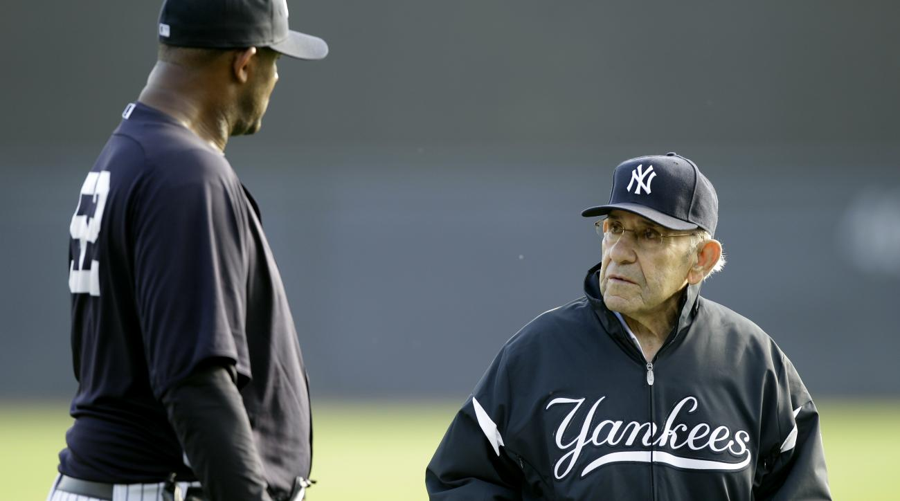 File-This Feb. 24, 2011, file photo shows New York Yankees pitcher CC Sabathia,left, talking with Yogi Berra, right, during a baseball spring training workout at Steinbrenner Field in Tampa, Fla. Berra, the Yankees Hall of Fame catcher has died. He was 90