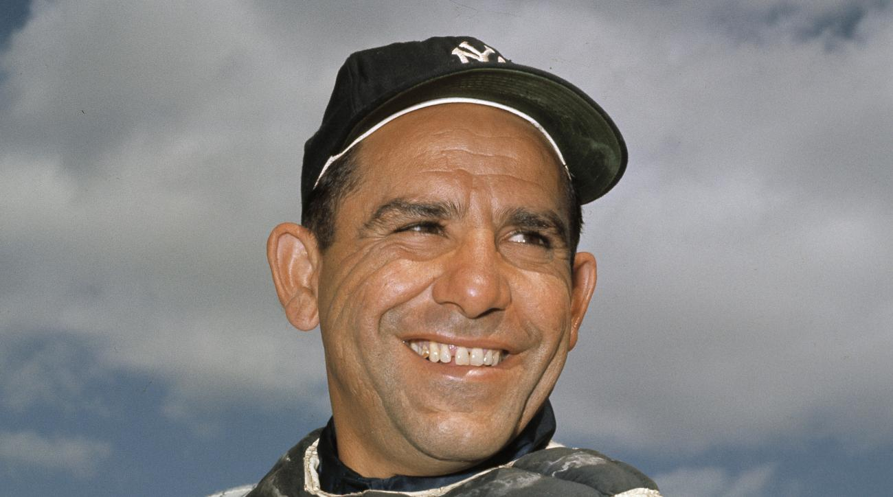 """FILE - It this undated file photo, New York Yankee catcher Yogi Berra poses at spring training in Florida. The Hall of Fame catcher renowned as much for his lovable, linguistically dizzying """"Yogi-isms"""" as his unmatched 10 World Series championships with t"""