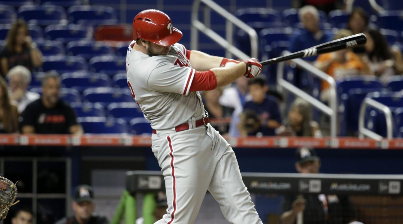 Philadelphia Phillies' Darin Ruf hits a single in the fifth inning of a baseball game against the Miami Marlins, Wednesday, Sept. 23, 2015, in Miami. (AP Photo/Lynne Sladky)