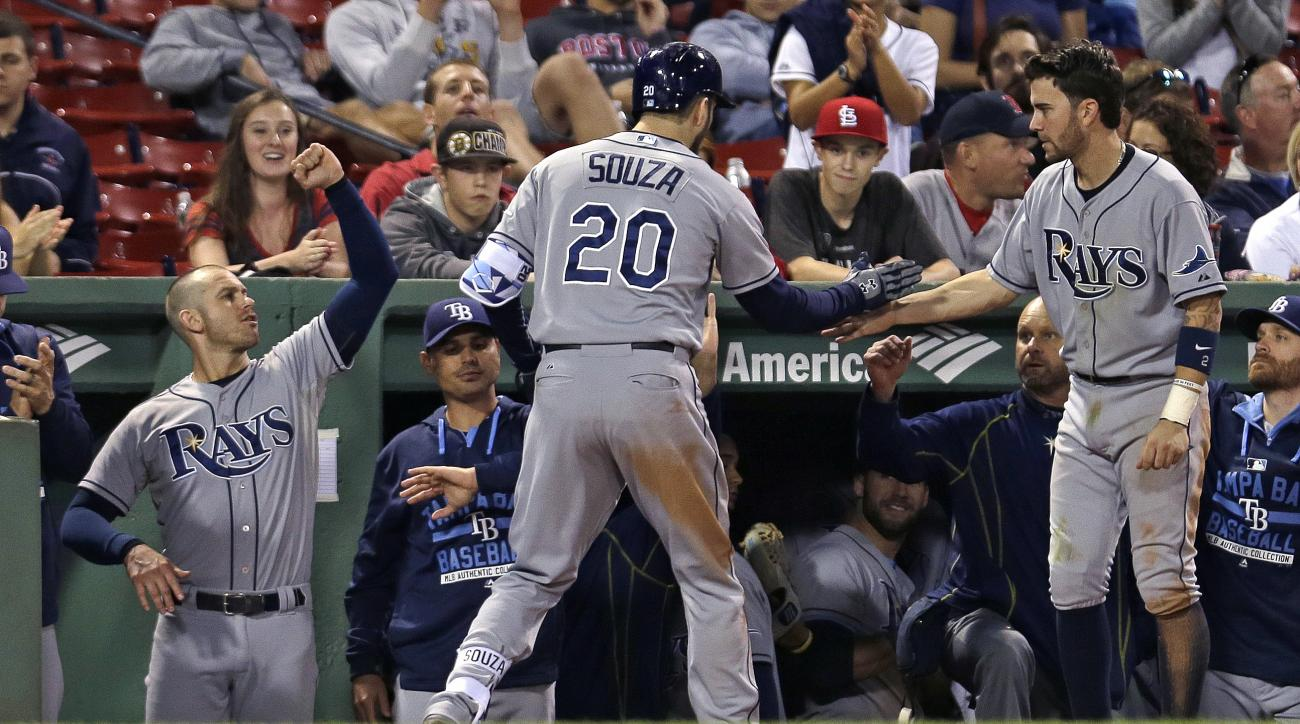 Tampa Bay Rays' Steven Souza Jr. (20) is congratulated by teammates after his solo home run in the ninth inning of a baseball game against the Boston Red Sox at Fenway Park in Boston, Wednesday, Sept. 23, 2015. (AP Photo/Charles Krupa)