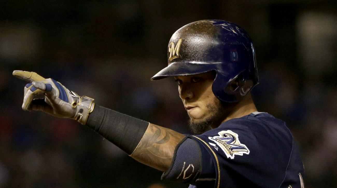 Milwaukee Brewers' Martin Maldonado celebrates after hitting an RBI single against the Chicago Cubs during the ninth inning of a baseball game Wednesday, Sept. 23, 2015, in Chicago. (AP Photo/Nam Y. Huh)