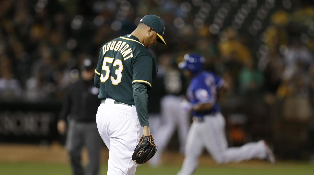 Oakland Athletics' Felix Doubront (53) waits for Texas Rangers' Adrian Beltre, rear, to run the bases after Doubront gave up a three-run home run to Beltre during the fifth inning of a baseball game Wednesday, Sept. 23, 2015, in Oakland, Calif. (AP Photo/