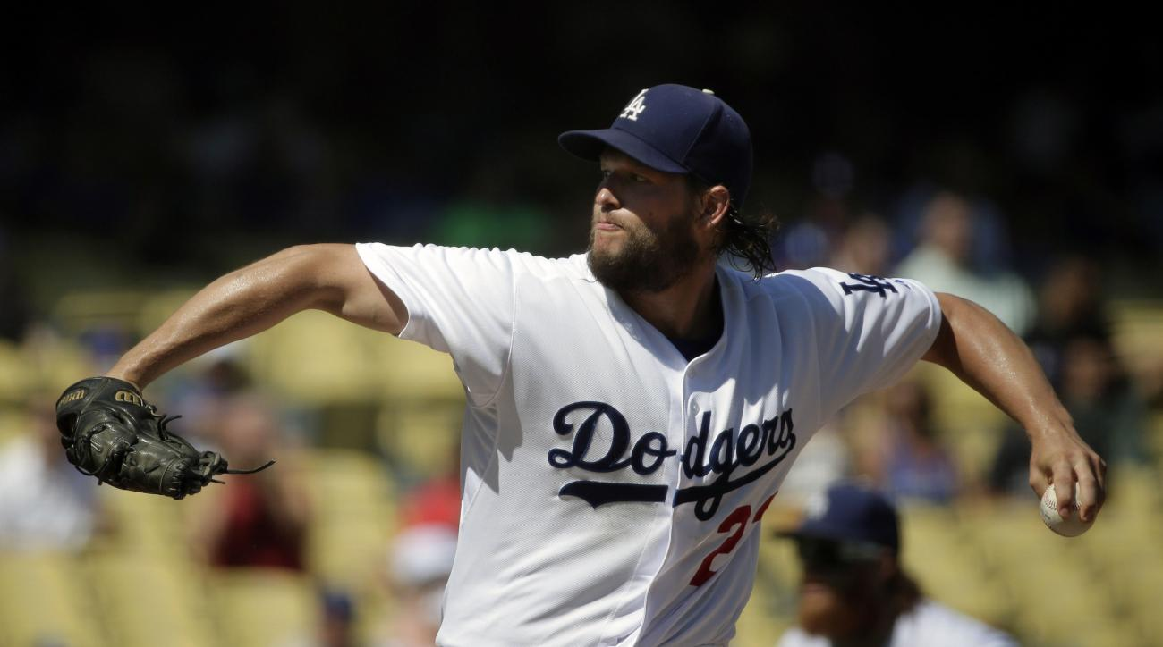 Los Angeles Dodgers starting pitcher Clayton Kershaw  throws against the Arizona Diamondbacks during the first inning of a baseball game in Los Angeles, Thursday, Sept. 24, 2015. (AP Photo/Chris Carlson)
