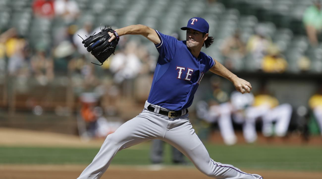 Texas Rangers pitcher Cole Hamels works against the Oakland Athletics in the first inning of a baseball game Thursday, Sept. 24, 2015, in Oakland, Calif. (AP Photo/Ben Margot)