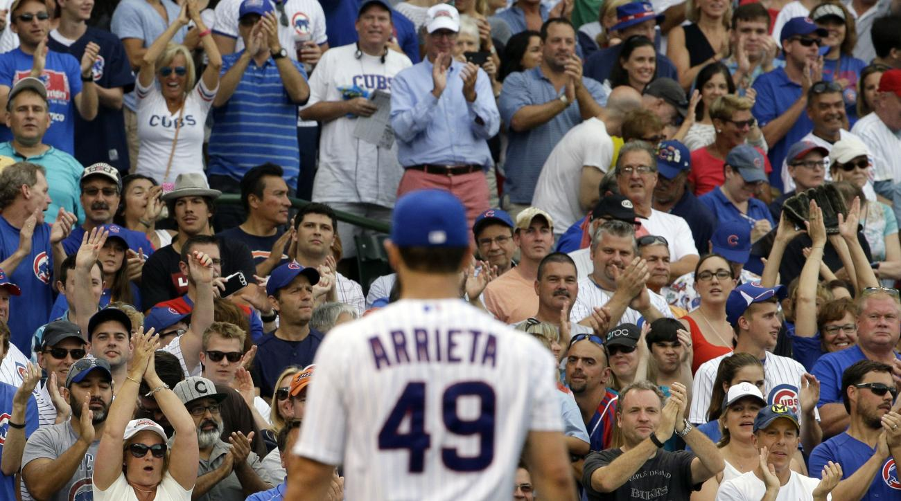 FILE - In this Sunday, Aug. 9, 2015 file photo, Chicago Cubs fans cheer for starter Jake Arrieta (49) during the sixth inning of a baseball game against the San Francisco Giants in Chicago. The Cubs own the majors' third best record through Tuesday, Sept.